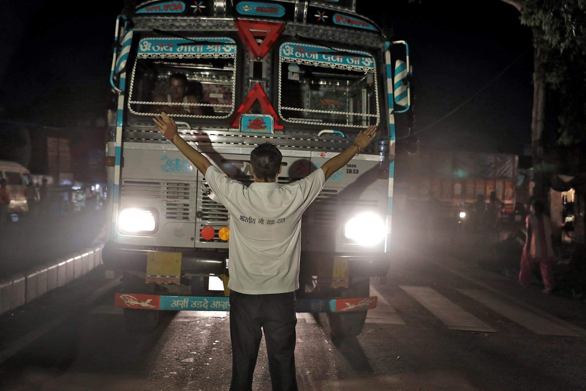 Pawan Pandit, a cow vigilante, stops a lorry at a road block near Chandigarh, India, July 6, 2017. (Reuters)