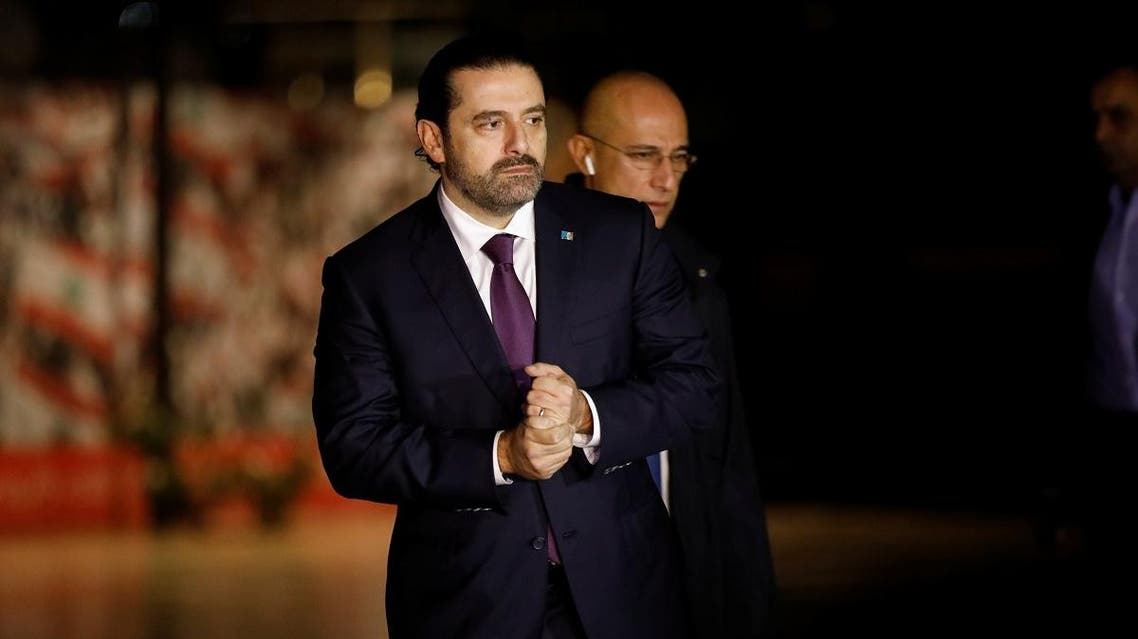Saad al-Hariri, who announced his resignation as Lebanon's prime minister from Saudi Arabia, is seen at the grave of his father, assassinated former Lebanese prime minister Rafik al-Hariri. (Reuters)
