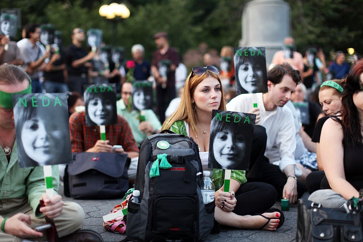 Demonstrators gather in Union Square to mark the 40th day since the death Neda Agha Soltan, a young woman who was killed during post-election protests last month in Tehran on July 30, 2009 in New York City. (AFP)