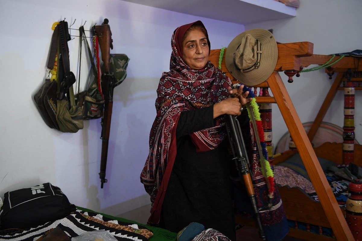 As 200 armed men surrounded their house on a hot August night in 2005, Nazo Dharejo and her sisters grabbed their Kalashnikov and puny stock of ammunition and climbed to the roof. (AFP)