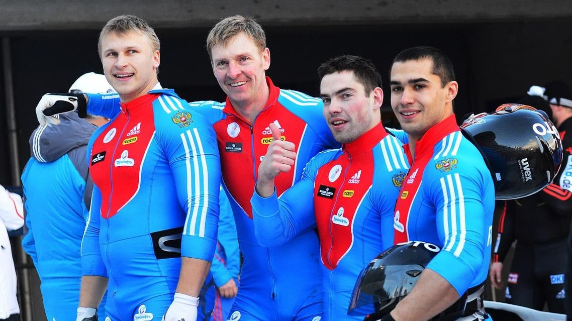 Russia's Alexey Negodaylo,Alexander Zubkov, Maxim Mokrousov and Dmitry Trunenkov , from left to right, pose for the media after winning four-man bobsled World Cup event at lake Koenigssee, Germany, Sunday, Jan. 13, 2013. (AP)