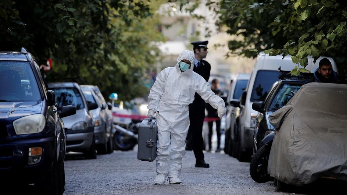 A forensics officer carries equipment following an operation in which Greek security services raided Athens apartments and found bomb-making equipment, in Athens. (Reuters)
