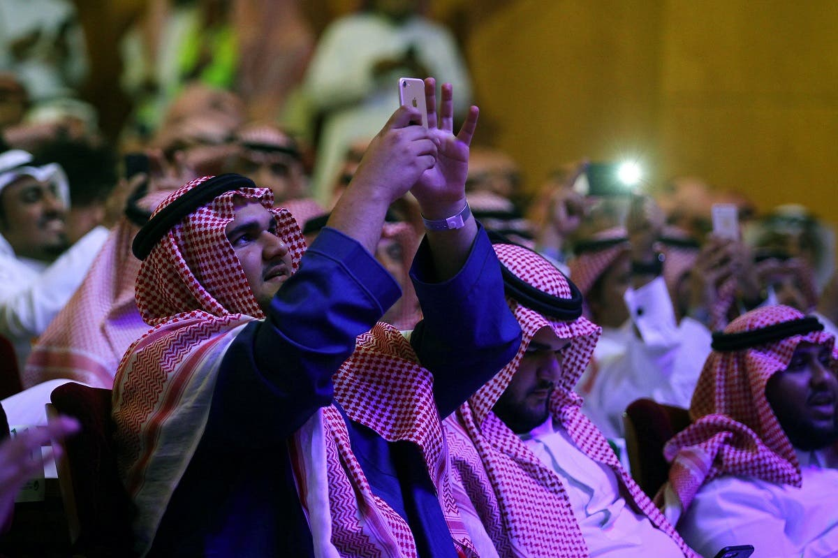 Spectators take pictures during a concert by Saudi Arabian singers Mohammed Abdu and Rashed Al-Majed in Riyadh, Saudi Arabia, March 9, 2017.