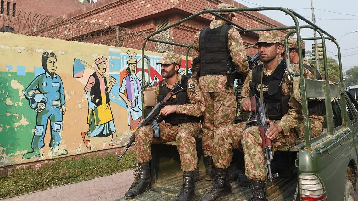 Pakistani army soldiers patrol outside the Gaddafi Cricket Stadium in Lahore on October 27, 2017. (AFP)