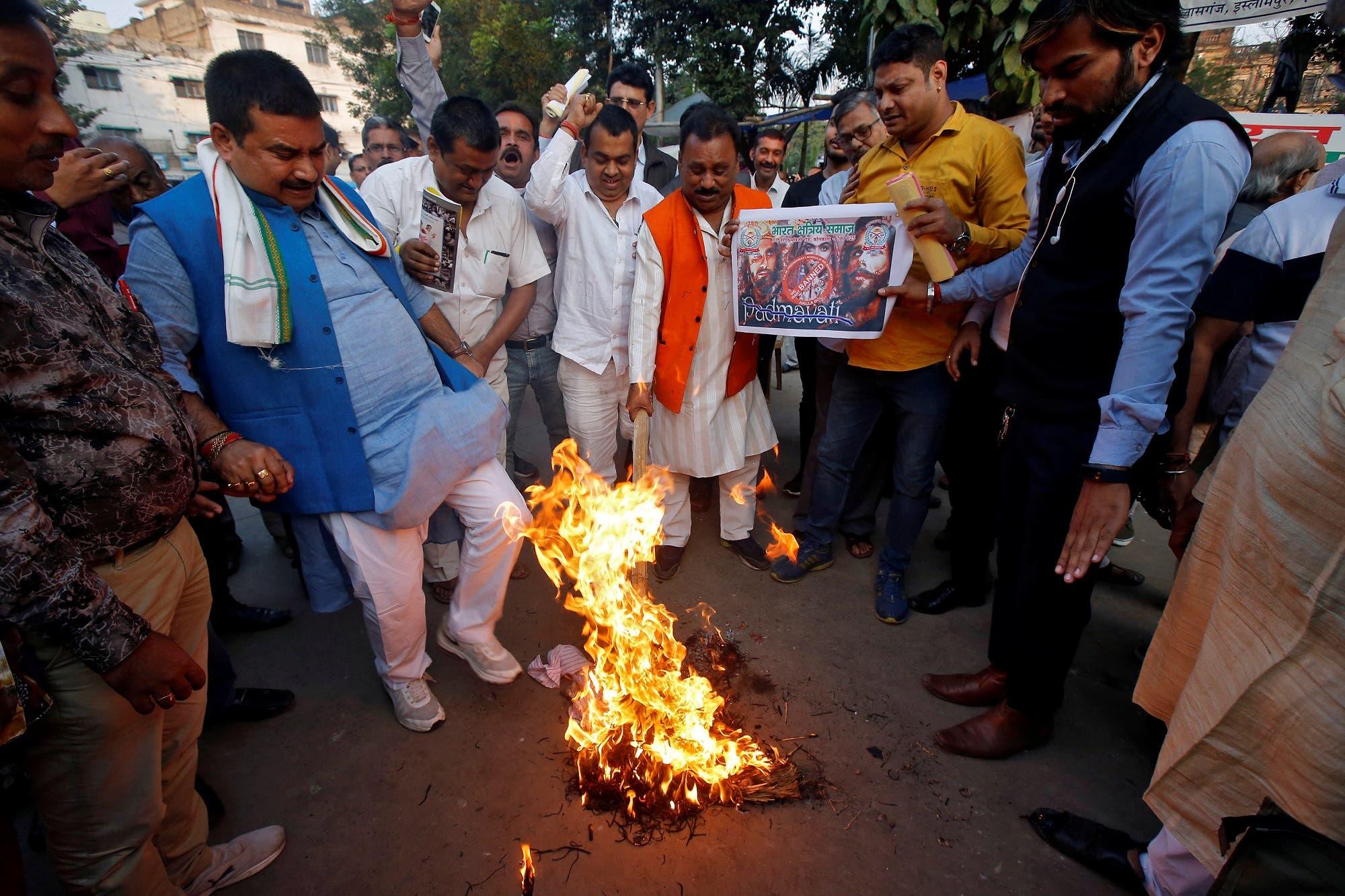 "Demonstrators burn an effigy depicting film director Sanjay Leela Bhansali during a protest against ""Padmavati"" in Kolkata on November 22, 2017. (Reuters)"