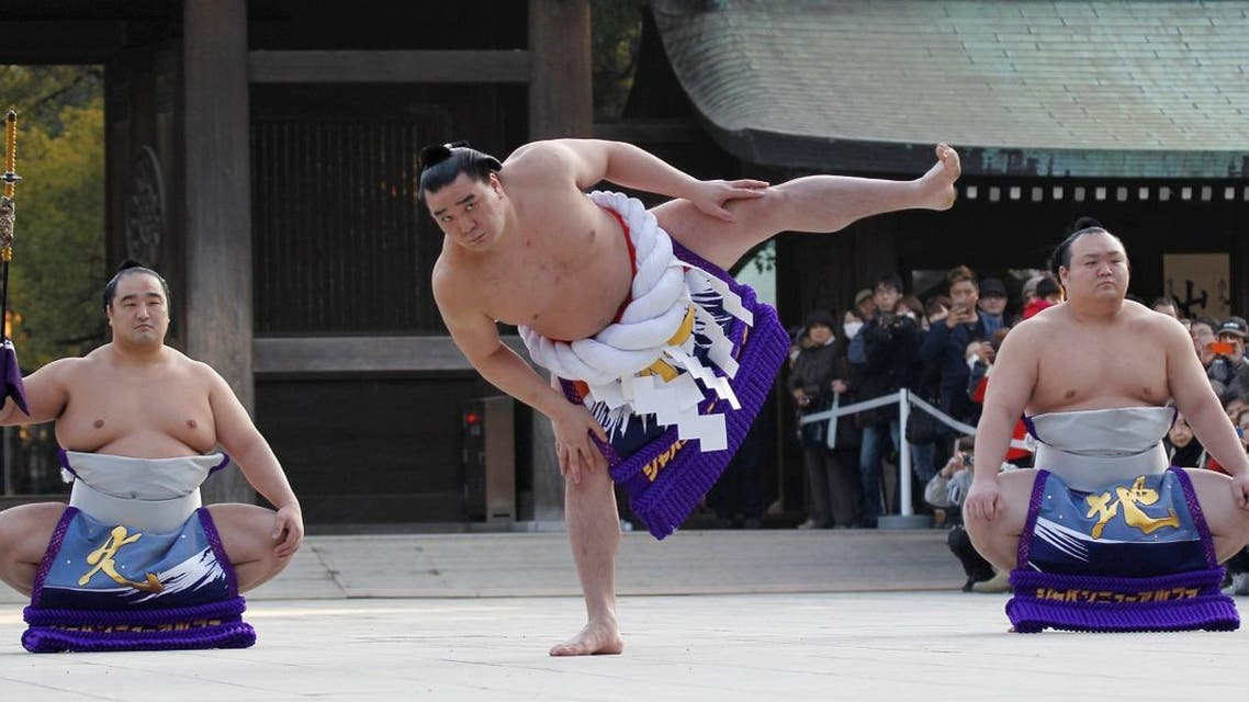 Mongolian-born grand sumo champion Yokozuna Harumafuji performs the New Year's ring-entering rite at the annual celebration for the New Year at Meiji Shrine in Tokyo. (Reuters)