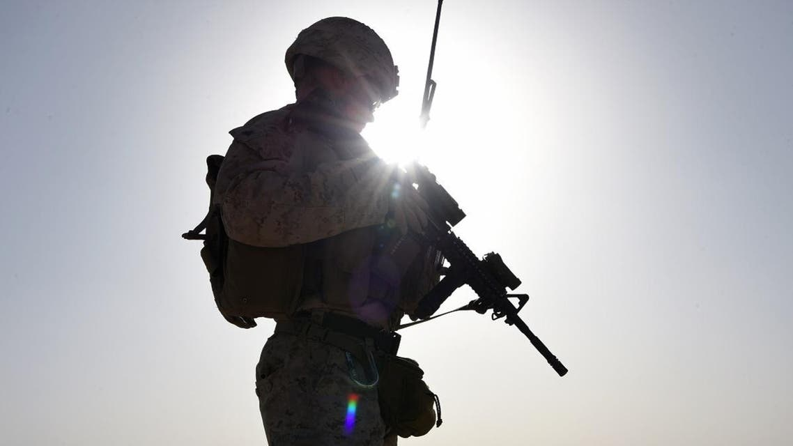 In this photograph taken on August 27, 2017 a US Marine watches Afghan Commandos take part in a combat training exercise at Shorab Military Camp in Lashkar Gah in Helmand province. (AFP)