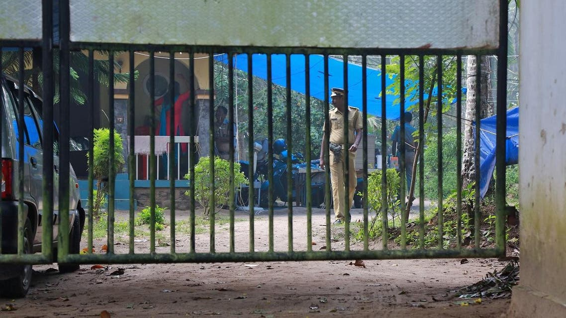 Police officers guard inside the premises of K M Ashokan, father of 24-year-old Akhila, who converted to Islam in 2016 and took a new name, Hadiya, at Vaikom in the Kottayam district of the southern state of Kerala, India November 23, 2017. (Reuters)