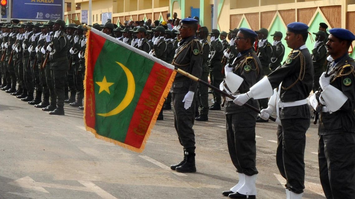 A Mauritanian soldier holds the country's new flag during a parade marking the national day, on November 28, 2017.  AFP