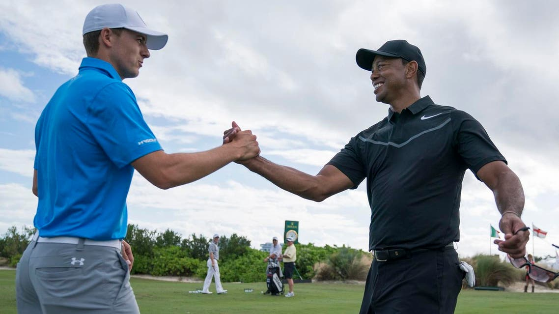 Jordan Spieth (left) shakes hands withTiger Woods (right) on the driving range during practice round of the Hero World Challenge golf tournament. (Kyle Terada-USA TODAY/Reuters)