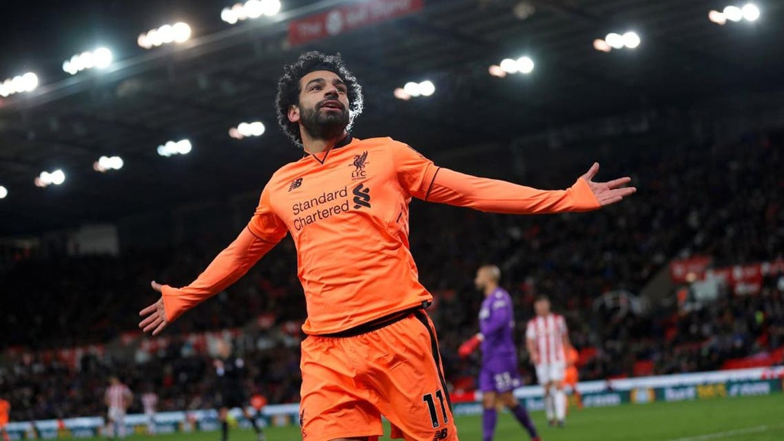 Liverpool's Mohamed Salah celebrates scoring their third goal. (Reuters)