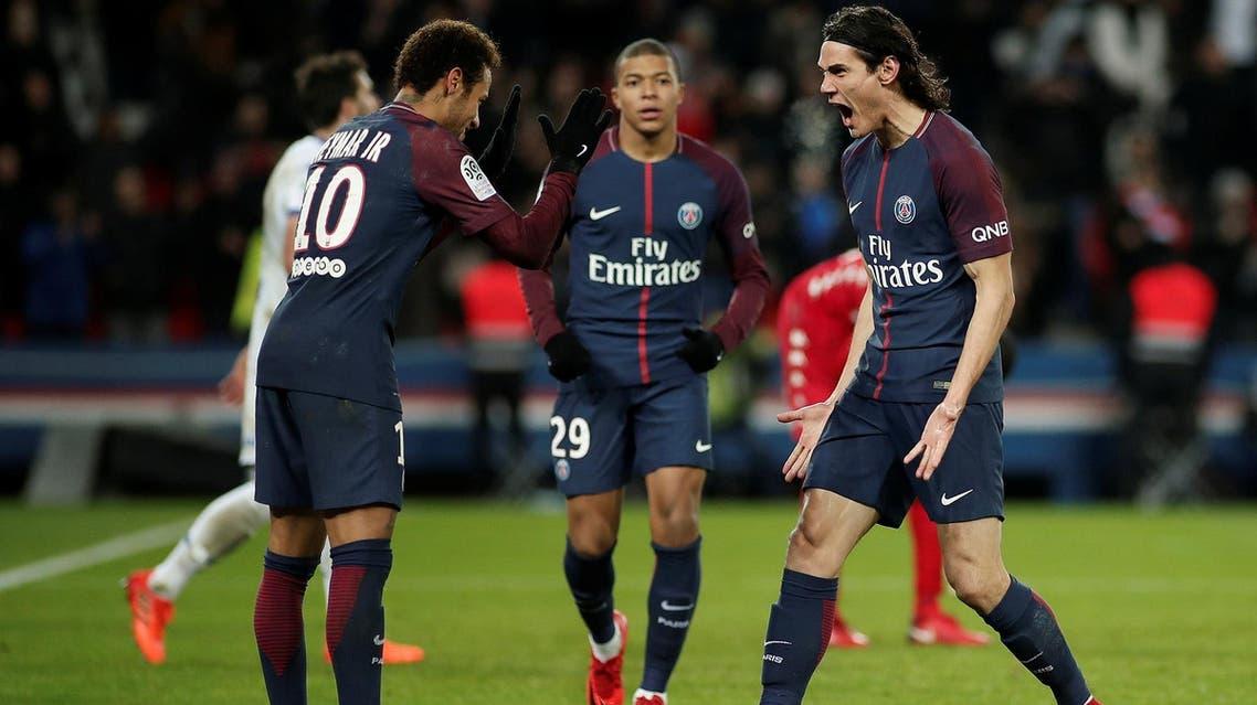 Paris Saint-Germain's Edinson Cavani celebrates scoring their second goal with Neymar. (Reuters)