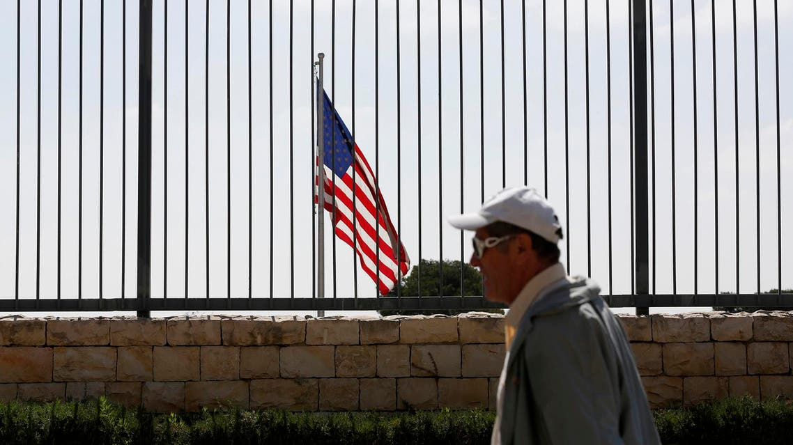 A pedestrian walks past the US consulate in Jerusalem August 4, 2013. (Reuters)