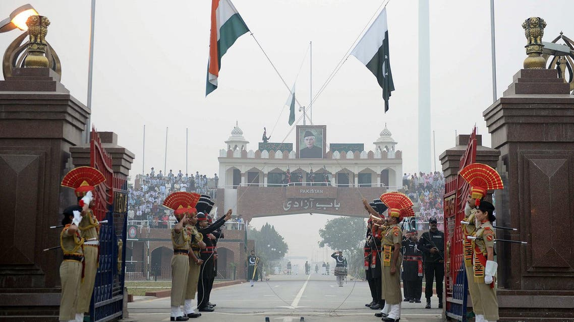 Pakistani Rangers and Indian Border Security Force personnel during the daily beating of the retreat ceremony at Wagah Border on October 30, 2017. (AFP)