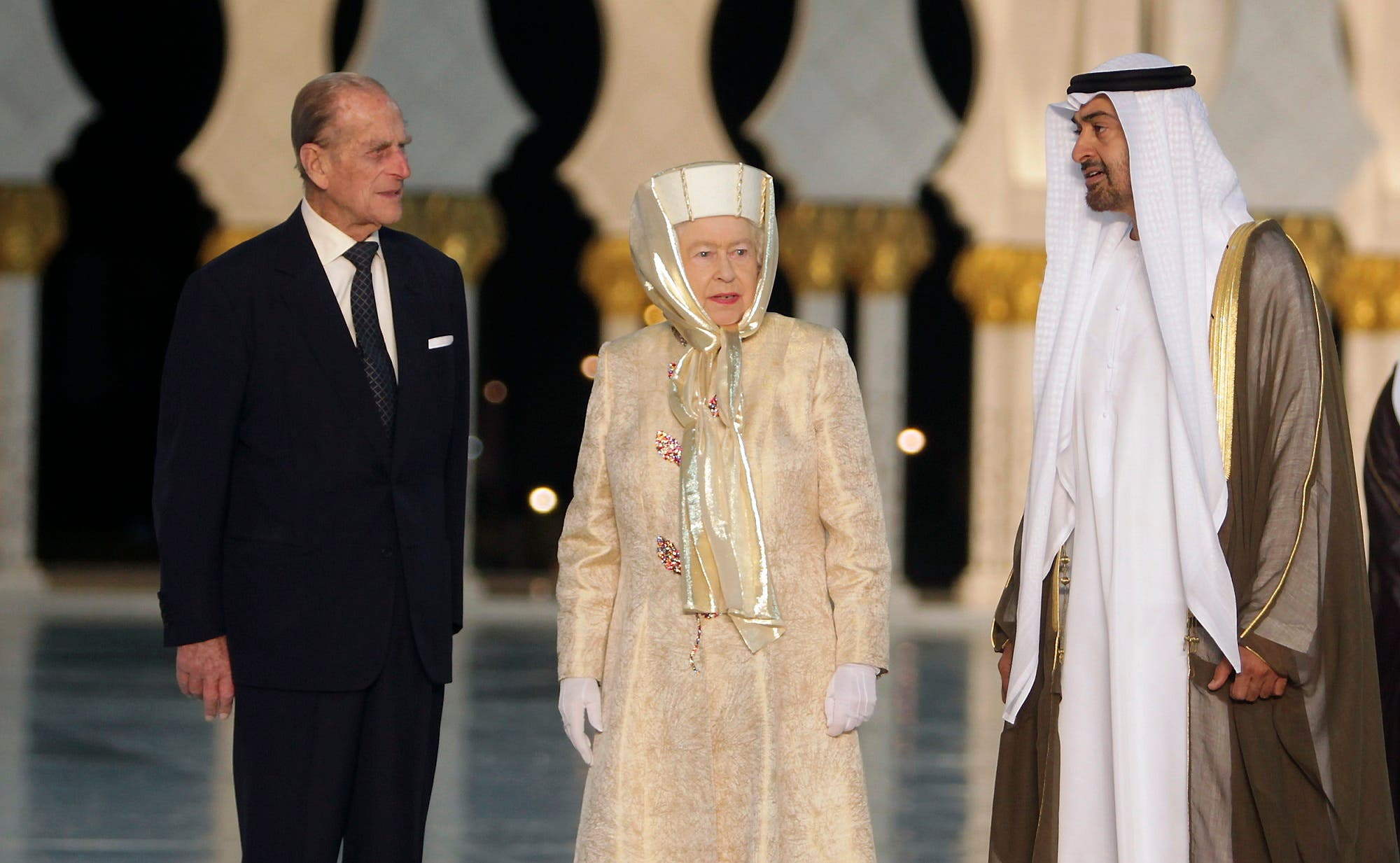 Britain's Queen Elizabeth and her husband Prince Philip stand next to Abu Dhabi's Crown Prince Sheikh Mohammed bin Zayed during their visit at the Sheikh Zayed Grand Mosque in Abu Dhabi November 24, 2010. (Reuters)