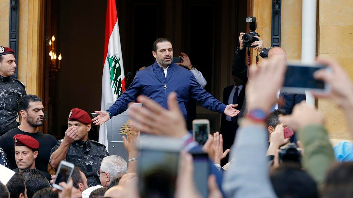 Lebanese Prime Minister Saad Hariri sings the Lebanese national anthem with thousands of his supporters who rallying outside his residence in Beirut, Lebanon, Wednesday, Nov. 22, 2017.(AP)
