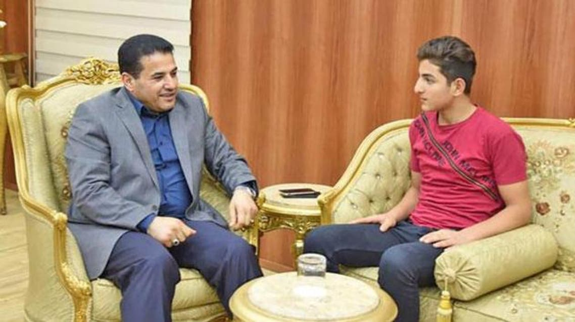 This handout photo taken from the official Facebook page of Iraq's Interior Minister Qasim Al Araji on Thursday, shows Al Araji (left) meeting on August 20 with 15-year-old Iraqi Youth Osama Bin Laden at the minister's office in Baghdad (AFP photo)