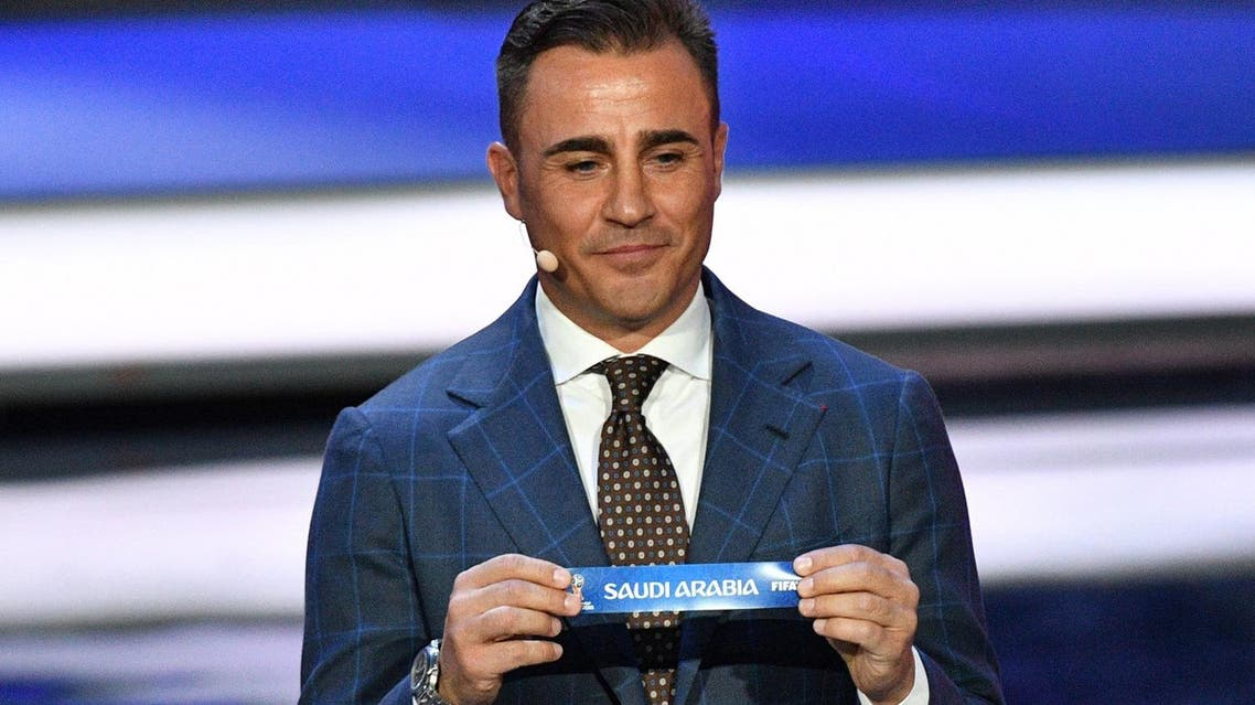 Italy's former defender and Guangzhou Evergrande's coach Fabio Cannavaro displays the slip of Saudi Arabia during the Final Draw for the 2018 FIFA World Cup. (AFP)