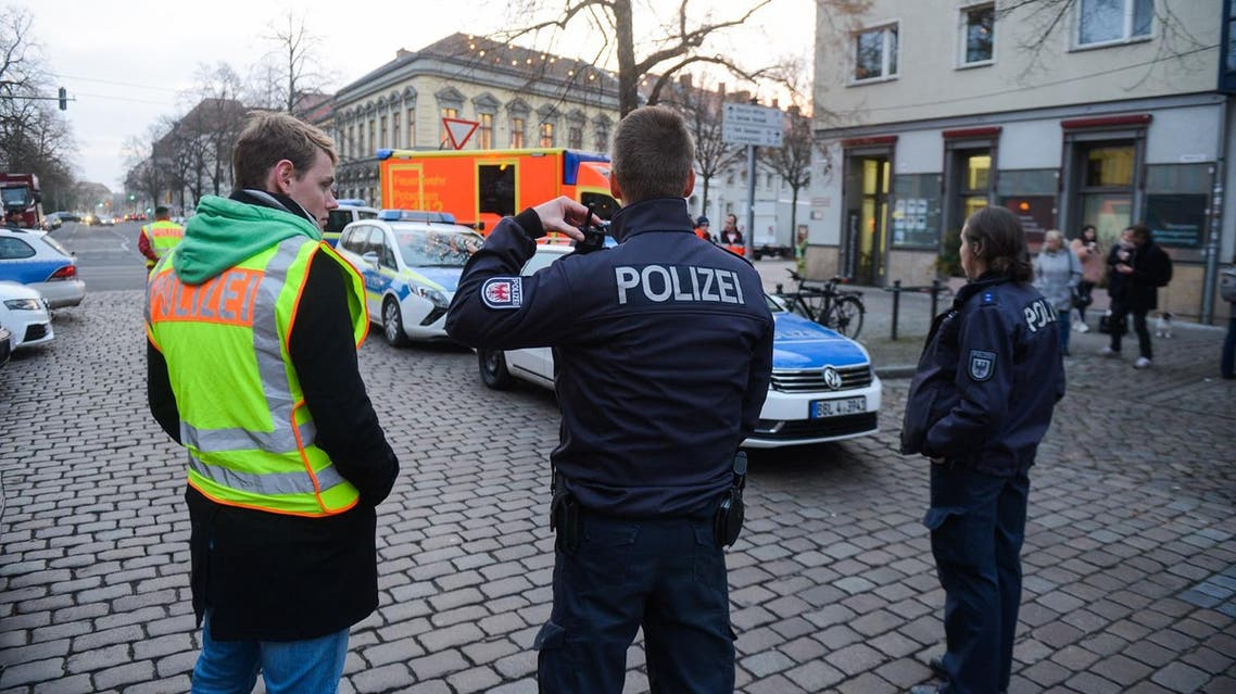 German policemen stand guard on a street on December 1, 2017, after a suspicious object prompted the evacuation of a Christmas market in Potsdam. (AFP)