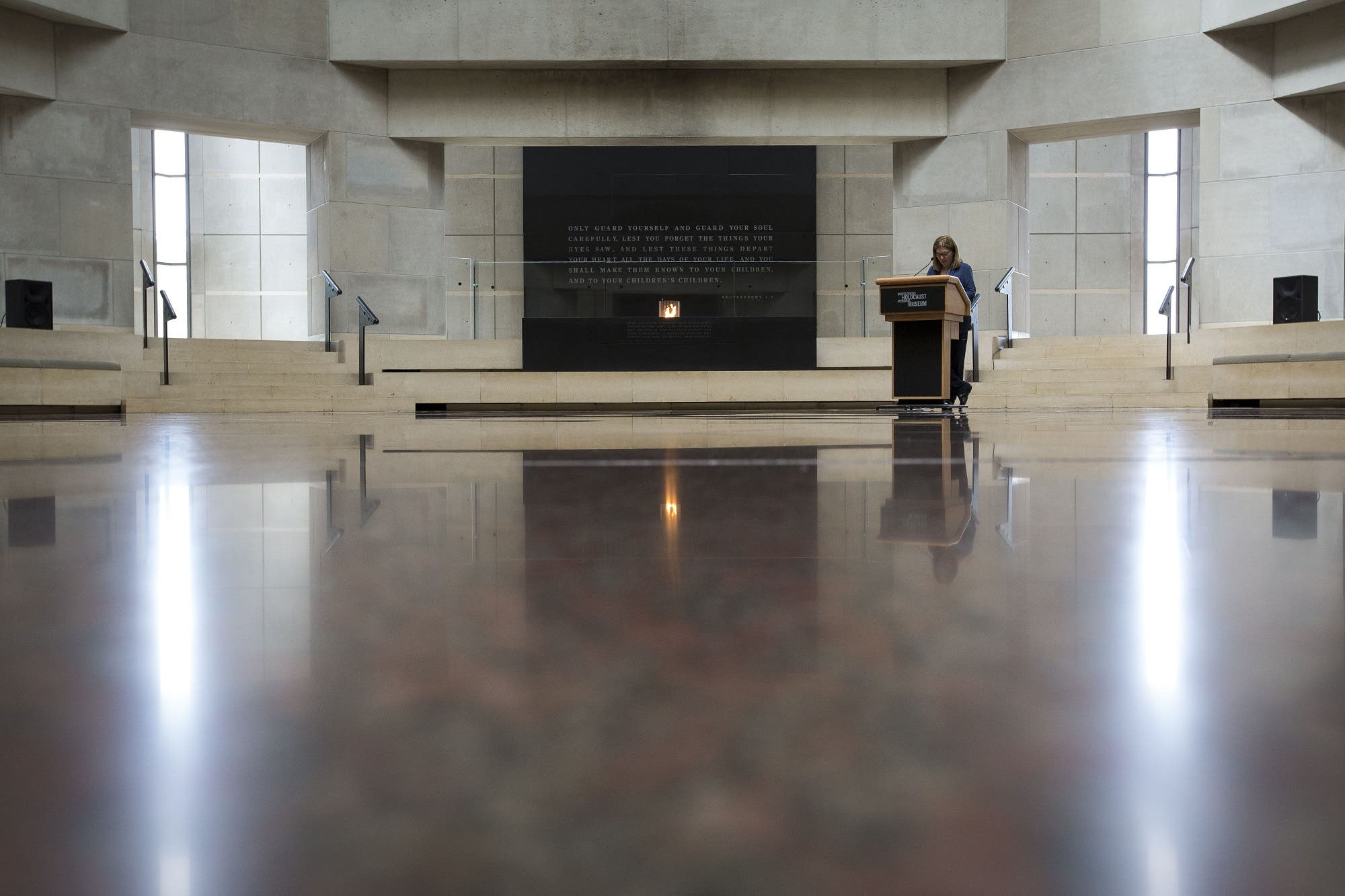 A volunteer reads names during the annual Names Reading ceremony to commemorate those who perished in the Holocaust, in the Hall of Remembrance at the United States Holocaust Memorial Museum, May 2, 2016, in Washington, DC. (AFP)