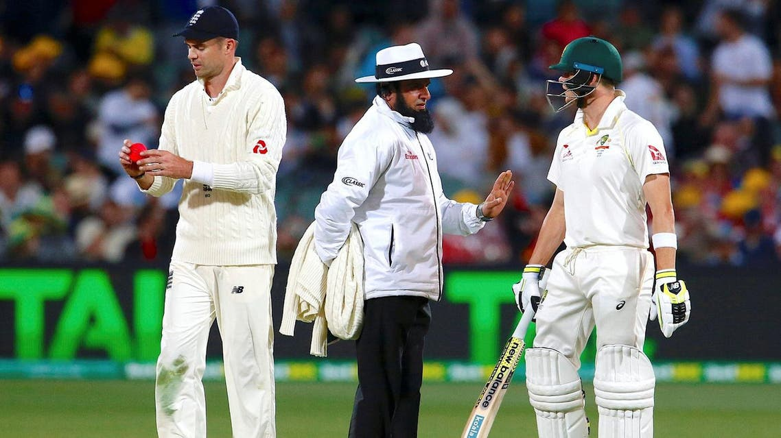 Umpire Aleem Dar stands between England's James Anderson and Australia's captain Steve Smith during the first day of the second Ashes cricket test match. (Reuters)
