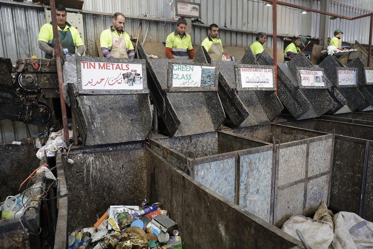 Workers are seen at a waste treatment plant in the area of Monteverde east of Beirut. (AFP)