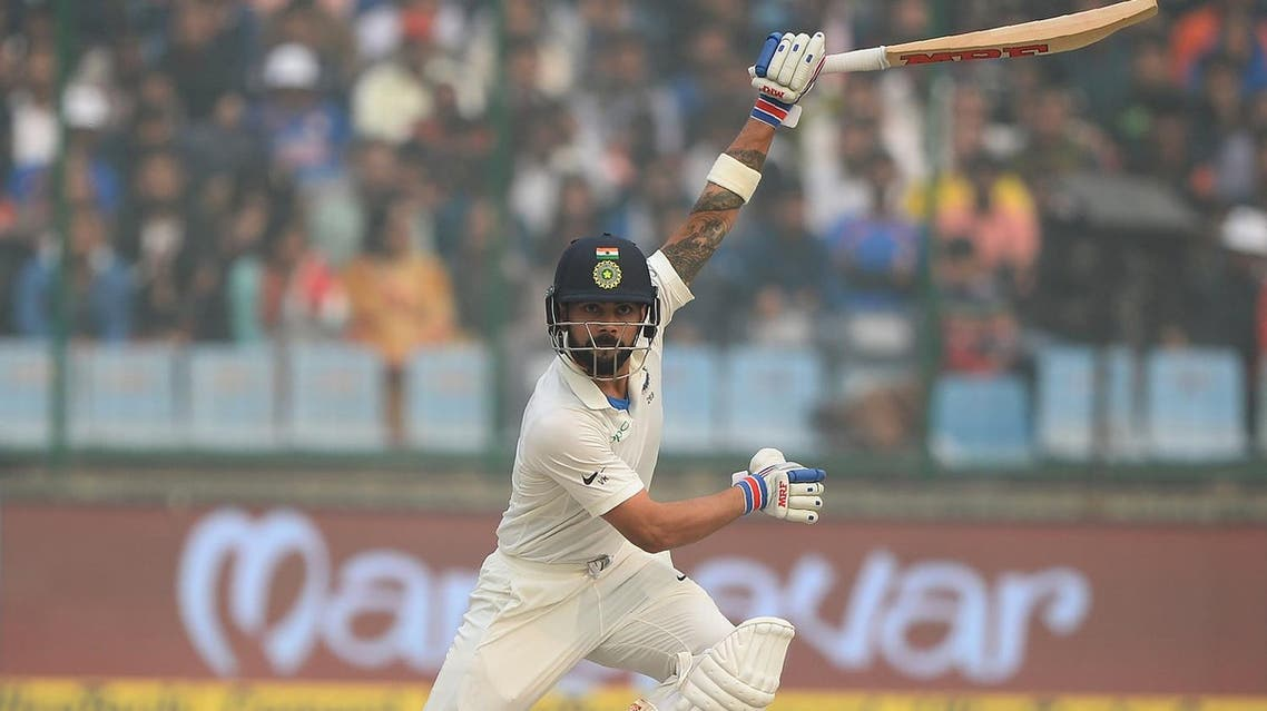 Indian batsman and team captain Virat Kohli (right) plays a shot during the second day of the third Test cricket match between India and Sri Lanka at the Feroz Shah Kotla Cricket Stadium in New Delhi on December 3, 2017. (AFP)