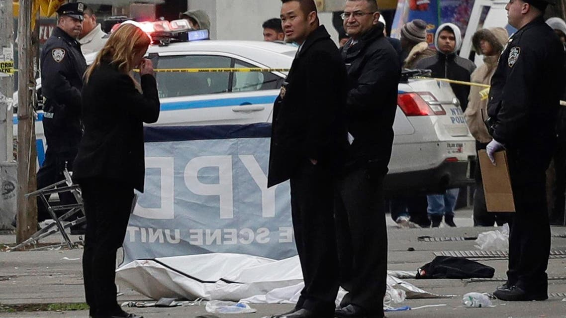 Police stand next to a victim in a body bag following an incident in the Queens borough of New York. (AP )