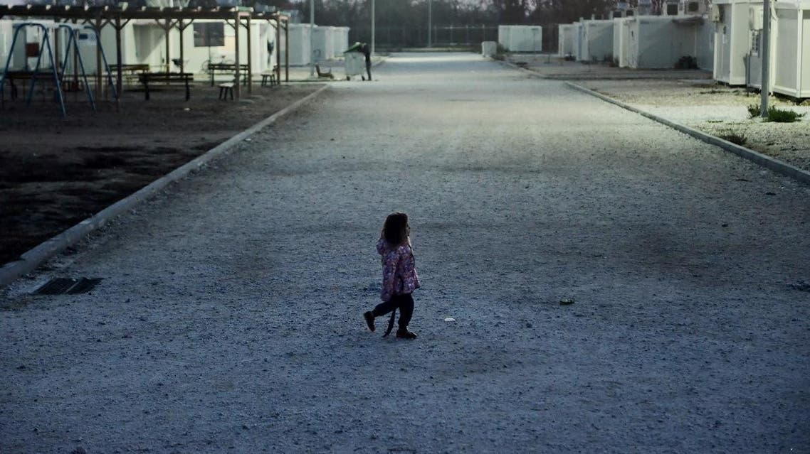 A Yazidi girl walks at the Serres refugee camp, northern Greece, on November 24, 2017. (AFP)