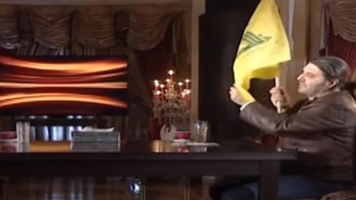 تاجر المخدرات حاملاً علم ميليشيات حزب الله اللبناني