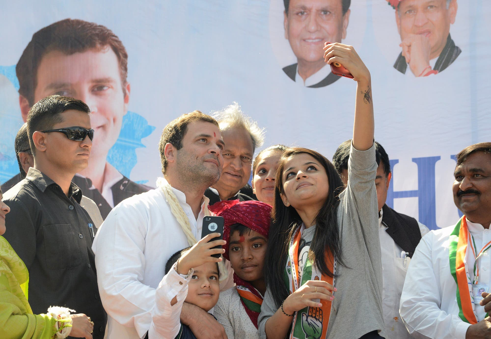 Rahul Gandhi takes a selfie photograph photo with supporters at a rally in Dahegam, some 40km from Ahmedabad, on November 25, 2017. (AFP)