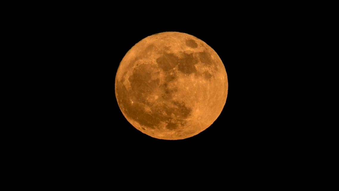 The lunar phenomenon occurs when a full moon is at its closest point to earth. (AFP)