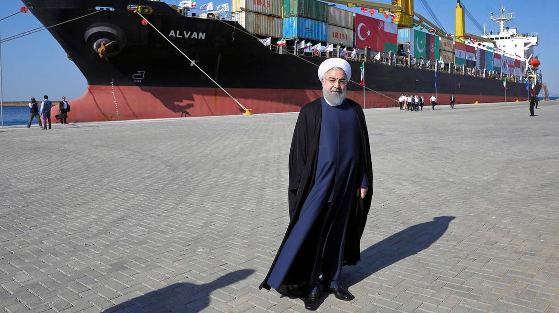Iranian President Hassan Rouhani poses during the inauguration of an extension of the port of Chabahar on the Gulf of Oman on Dec. 3, 2017. (AP)