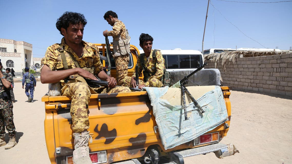 Pro-government police troopers ride on the back of a patrol truck in the northern city of Marib, Yemen November 4, 2017. Picture taken November 4, 2017. REUTERS/Ali Owidha