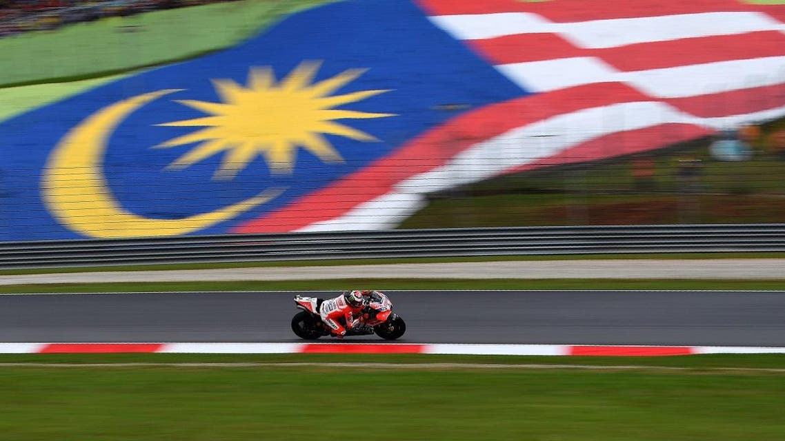 Ducati's Spanish rider Jorge Lorenzo powers his bike during the Malaysia MotoGP at the Sepang International circuit in Sepang on October 29, 2017. (AFP)