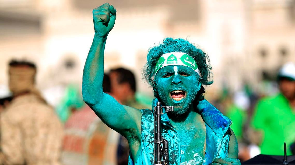 A Muslim Yemeni, covered with green paint, chants slogans as he attends a rally in the capital Sanaa on the occasion of the Prophet Mohammed's birthday on November 30, 2017. (AFP)