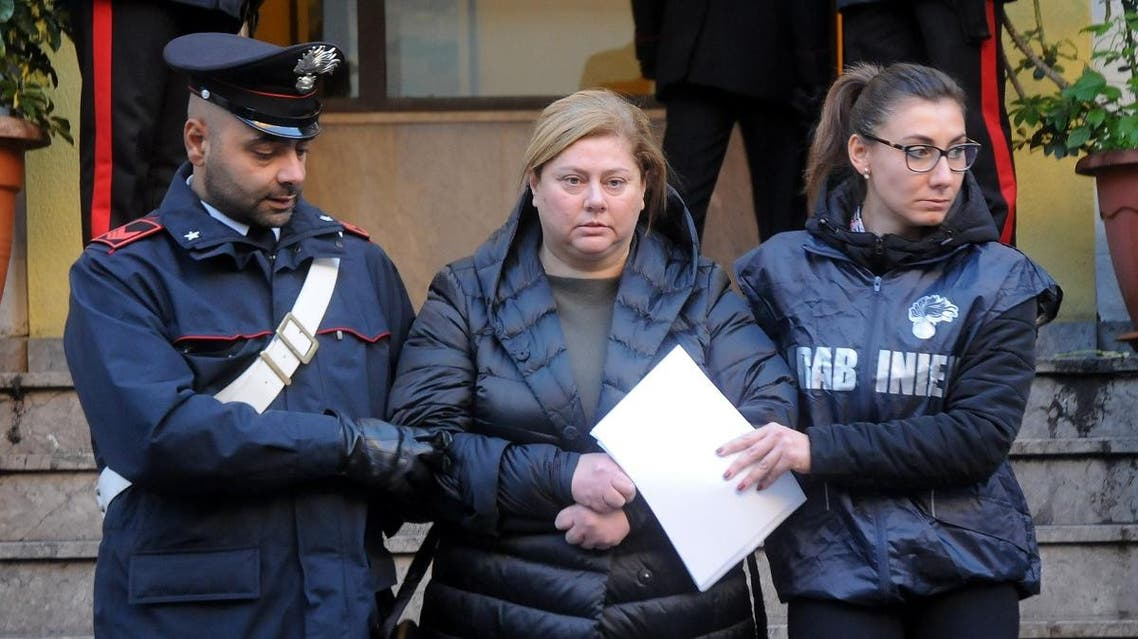 """Maria Angela Di Trapani (C), a female mobster suspected of being the mastermind behind a reshuffle of the Sicilian Mafia following the death of """"boss of bosses"""" Toto Riina. (AFP)"""