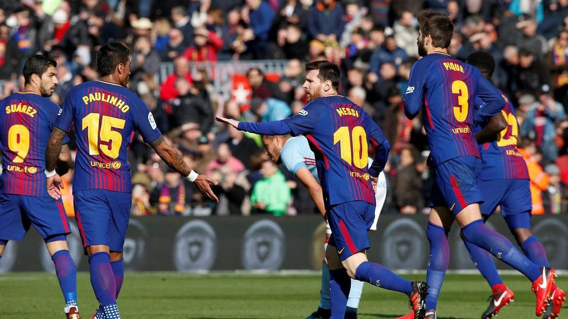 Barcelona's Lionel Messi celebrates with team mates after scoring their first goal. (Reuters)