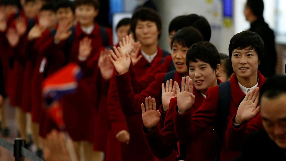 North Korea's women's national soccer team arrive for the EAFF E-1 Football Championship at Haneda international airport in Tokyo. (Reuters)