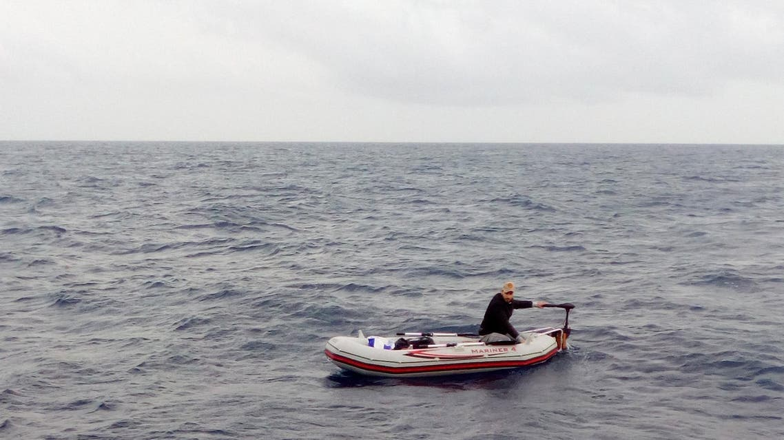 In this photo taken on Dec. 1, and made available on Dec. 4, 2017, a Syrian refugee is spotted in his 3-meter (10-foot) long rubber boat some 25 miles off Libya's coast by the NGO rescue boat of Proactiva Open Arms. The man, 30, who had set out solo in his tiny rubber boat trying to reach the Lampedusa Island, was rescued by the NGO boat. According to rescuers he was suffering from shock. (Proactiva Open Arms/via AP Photo)