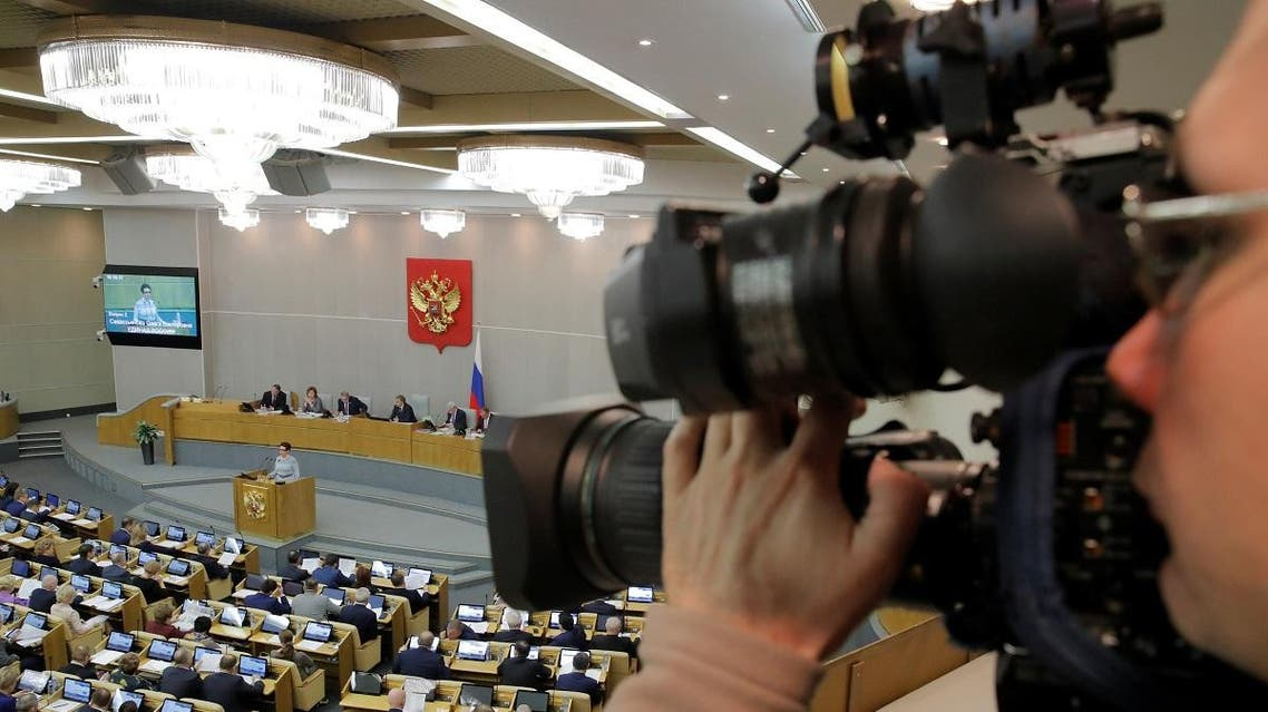 A cameraman films a morning session at the State Duma, the lower house of parliament, in Moscow. (AFP)