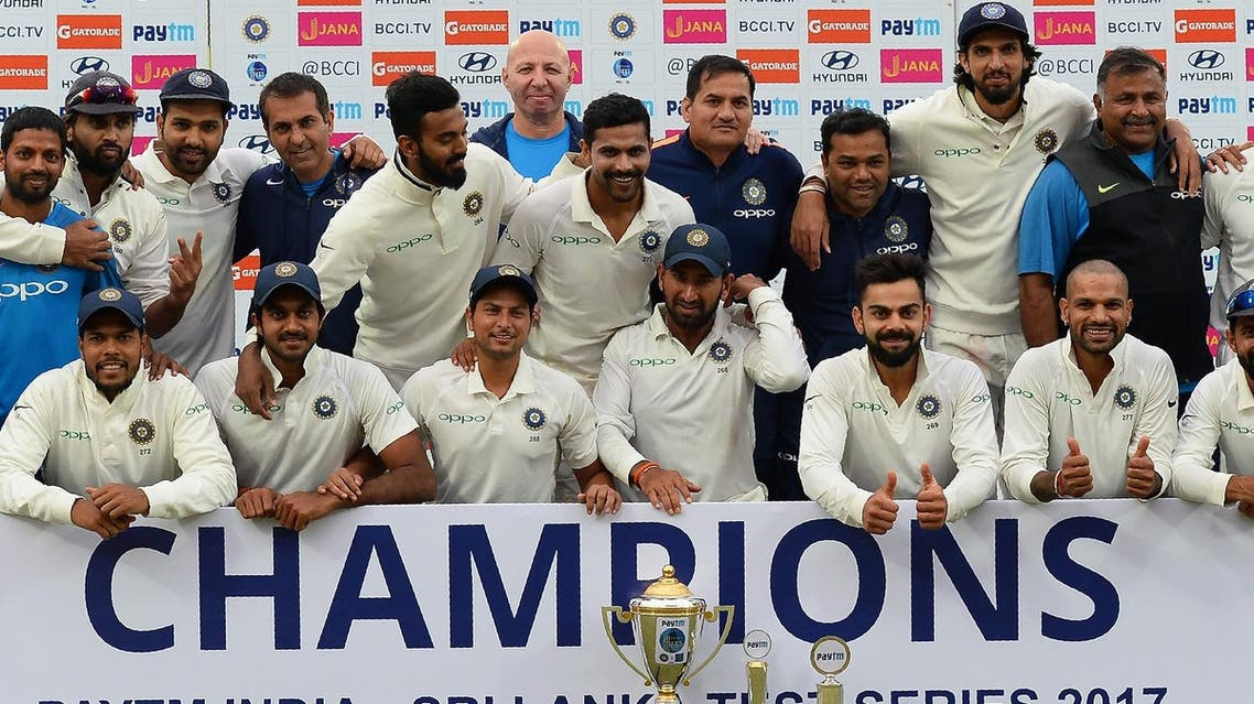 The Indian cricket team pose with the trophy after winning the third Test cricket match series against Sri Lanka by 1-0 at the Feroz Shah Kotla Stadium in New Delhi on December 6, 2017. (AFP)
