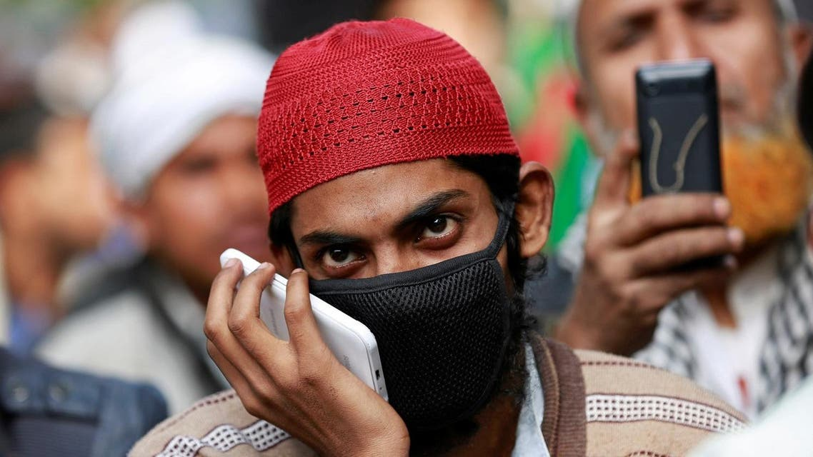 A man wears a face mask in New Delhi, India, December 6, 2017. REUTERS