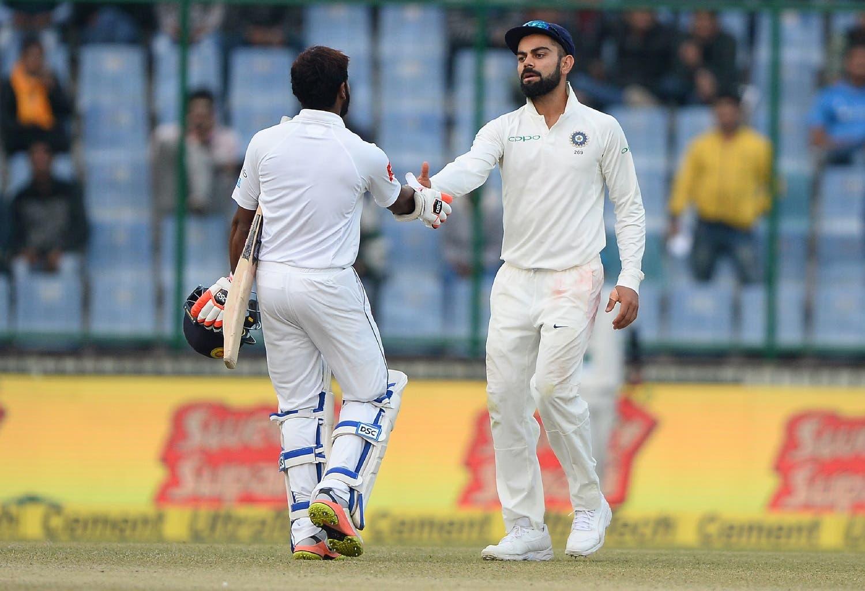 Indian team captain Virat Kohli (R) shakes hands with Sri Lanka batsman Niroshan Dickwella at the end of the third Test cricket in New Delhi on December 6, 2017. (AFP)