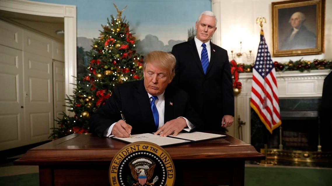 President Trump signs order on Jerusalem in the Diplomatic Room of the White House in Washington. (Reuters)