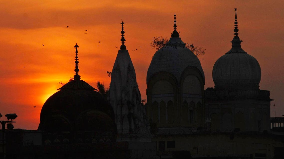 Birds fly at sunset over a Hindu temple on the 20th anniversary of the Babri mosque demolition in Ayodhya, India, on Dec. 6, 2012. (AP)