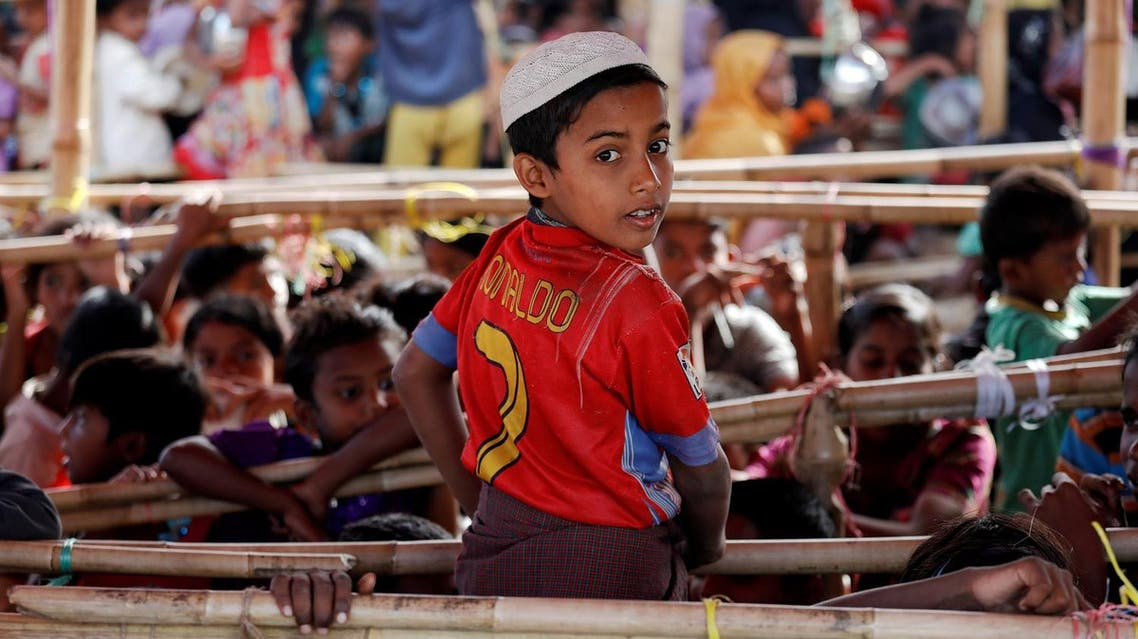 Mohammad Alam, a 10-year-old Rohingya refugee, poses in a T-shirt of his favorite player Cristiano Ronaldo as he joins other children waiting for food to be distributed at Tengkhali camp, near Cox's Bazar, Bangladesh December 7, 2017. (Reuters)
