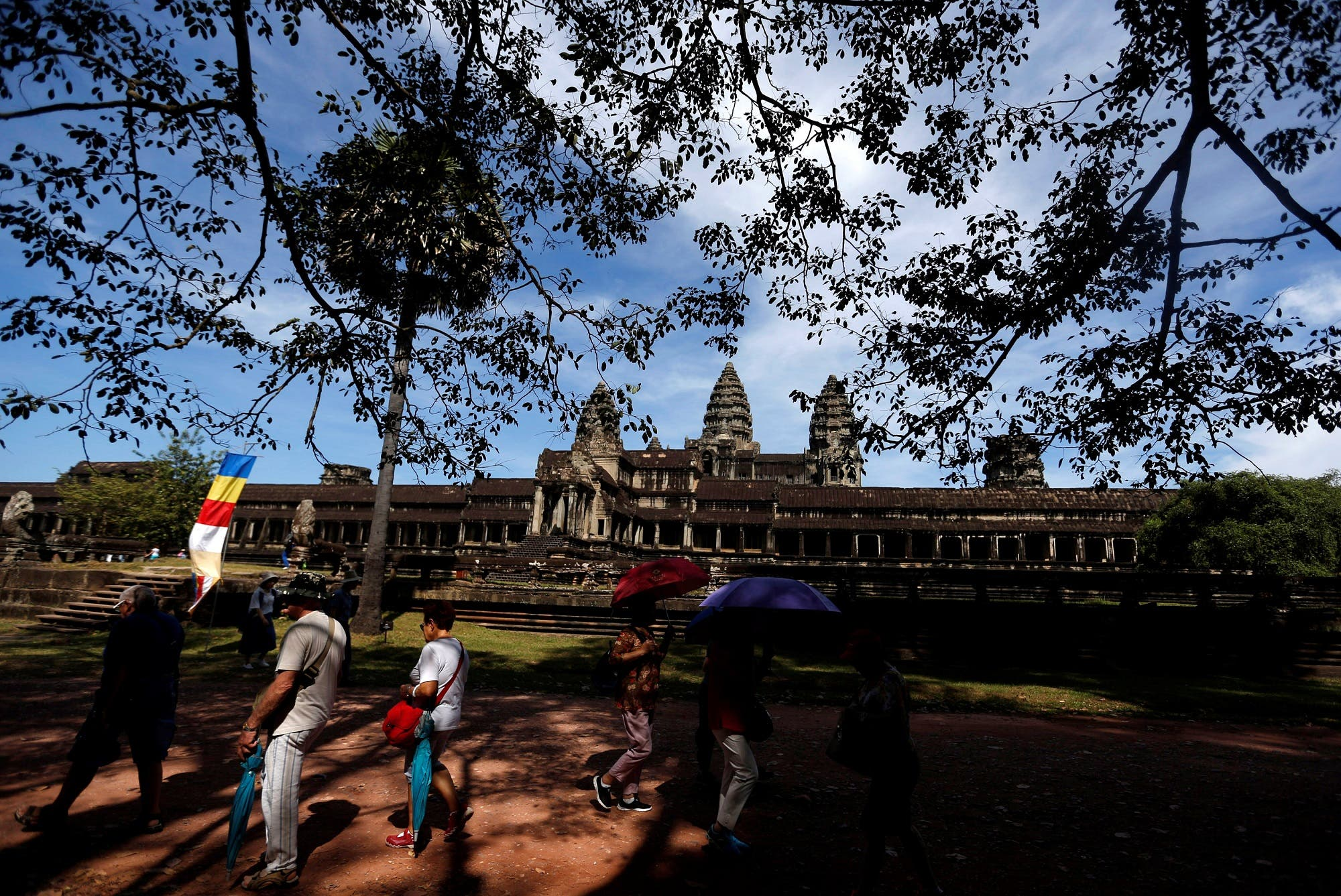 Tourists visit the Angkor Wat temple complex in Siem Reap province, Cambodia, December 2, 2017. (Reuters)