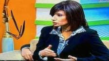 'Third hand' appears behind Egyptian TV anchor
