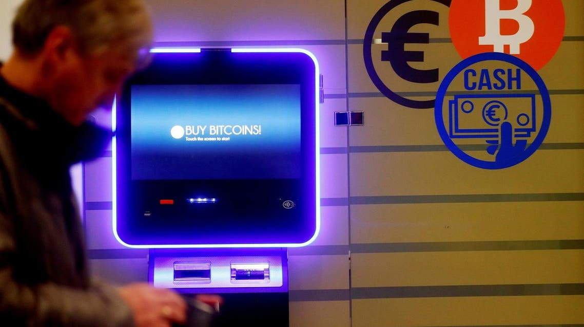 A man walks past a bitcoin ATM in Vilnius, Lithuania, on December 6, 2017. (Reuters)